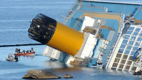 The cruise ship Costa Concordia lies stricken off the shore of the island of Giglio on January 21, 2012 in Giglio Porto, Italy. The body of a woman was recovered by Italian coast guard divers from the capsized cruise ship Costa Concordia, raising the death toll to 12. (Photo by Tullio M. Puglia/Getty Images)