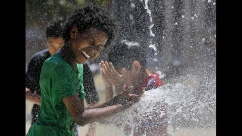 Aziz Taylor, 11, plays in a water fountain Monday in the Capitol Heights neighborhood of Washington.