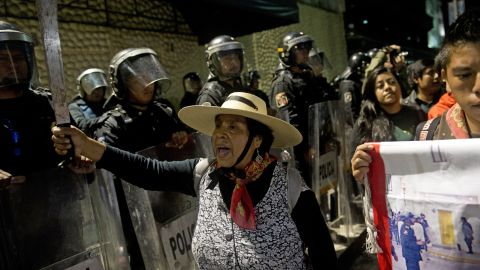 """Supporters of the Mexican university student movement """"I Am 132"""" protest in front of police outside the national TV network Televisa during a rally against the PRI and Peña Nieto in Mexico City on Saturday."""