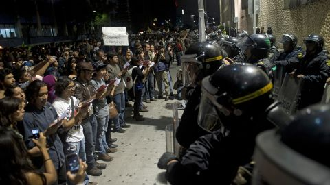 """Protesters supporting the """"I Am 132"""" movement rally outside Televisa headquarters in Mexico City on Saturday."""