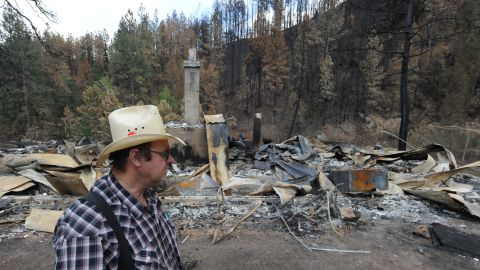 Frank Baker visits the remains of his brother's home in Bellvue, Colorado, on Saturday, June 30. The house was burned to the ground in the High Park Fire.