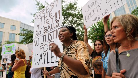 <strong>July 2011: </strong>The not-guilty charge divided many people who followed the case. Flora Reece, center, of Orlando is seen protesting the verdict outside the Orange County Courthouse.