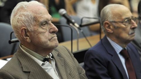 Former Argentine general and last dictator Reynaldo Bignone, left, and former Argentine general and dictator Jorge Rafael Videla attend the beginning of their trial on February 28, 2011.