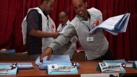 Election officials begin sorting ballots at a polling station in Tajura following Libya's General National Assembly election.