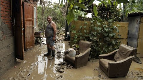 A man stands in the flooded ruin of his home in Krymsk, Russia, on Sunday.