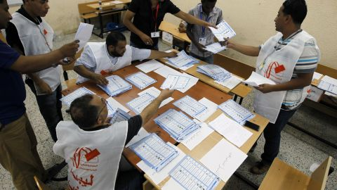 Election workers count votes at a polling station during the election Saturday in Benghazi.