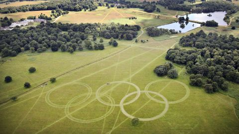 """With just days to go until the opening ceremony, organizers have cut Olympic rings into the grass in Richmond Park, south-west London, further promoting the green ambitions of the Games. David Stubbs, head of sustainability for London 2012 said: """"If you can put sustainability at the heart of a project which is the largest logistical exercise in peace time ... then you can do it anywhere."""""""