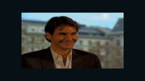 Roger Federer can't stop laughing during an interview with Pedro Pinto