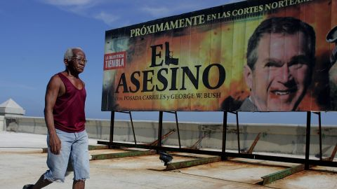 """A 2006 billboard in Havana reads """"Coming Soon to North American Courts: 'The Assassin' with Posada Carriles and George W. Bush."""""""