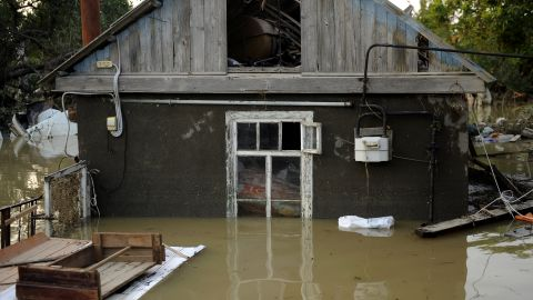 A home in the southern Russian town of Krymsk sits amid floodwaters that have yet to recede since setting in Friday.