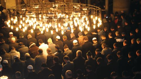 Tour participants join men in prayer in Istanbul.