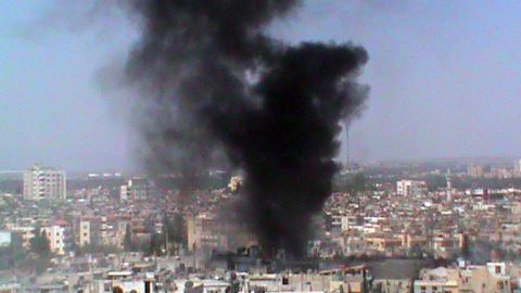 A picture released by the Syrian opposition shows smoke rising from a Homs neighborhood on Wednesday.