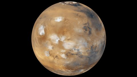 """Water-ice clouds, polar ice and other geographic features can be seen in this full-disk image of Mars from 2011. NASA's Mars Curiosity Rover touched down on the planet on August 6, 2012. Take a look at stunning photographs of Mars over the years.  <a href=""""http://www.cnn.com/2012/08/14/tech/gallery/mars-curiosity-rover/index.html"""" target=""""_blank"""">Check out images from the Mars rover Curiosity</a>."""
