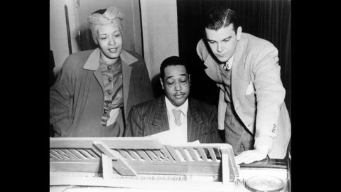 """Jazz singer Billie Holiday, left, and composer Duke Ellington, center, rehearse """"Symphony in Black: A Rhapsody of Negro Life"""" in 1935. Fans and artists are celebrating Lady Day, as she was known, on the 100th anniversary of her birth on April 7, 1915."""