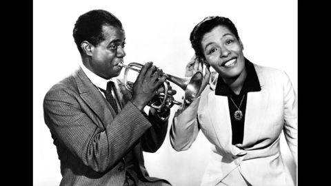 Louis Armstrong and Holiday pose for a portrait in 1939.