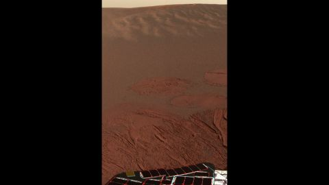 Pictured is the Martian landscape at Meridiani Planum, where the Mars Exploration Rover Opportunity successfully landed in 2004. This is one of the first images beamed back to Earth from the rover shortly after it touched down.