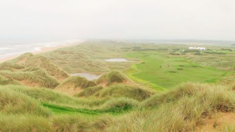 """Hailed by owner Donald Trump as """"the world's greatest golf course,"""" the American's new Scottish project mixes breathtaking views from elevated tees with classical links bunkers and wild rough. Dramatic, tall sand dunes frame many of the photogenic holes at Trump International. The true test of the course's standing will be its longevity and whether it matures into a stern test of championship golf."""