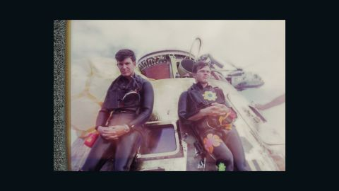 """Navy SEALs Wes Chesser, left, and John Wolfram pause after securing the Apollo 11 capsule on July 24, 1969. Wolfram wore 60s """"Flower Power"""" decals, showing his rebellious side. Chesser says, that only now does he realize how physically demanding the mission was. """"We were in such good shape."""""""