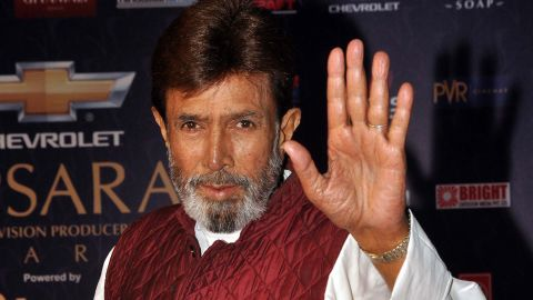 """Rajesh Khanna waves arrives for the """"7th Apsara Awards"""" during the ceremony in Mumbai, India, on January 25. Khanna's death was anounced Wednesday by his son-in-law, Akshay Kumar. He was 69."""