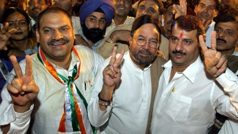 Khanna, center, who was elected to the lower house of the Indian parliament in 1992, shows a victory sign during a Congress Party election campaign meeting in New Delhi in November 2003.
