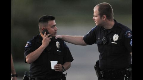 Officers gather at the theater July 20, 2012.