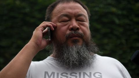 Ai Weiwei speaks to his lawyer from inside his compound in Beijing as the verdict of his court hearing is announced on July 20.