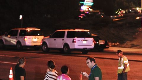 Onlookers gather outside the Century Aurora 16 theater.