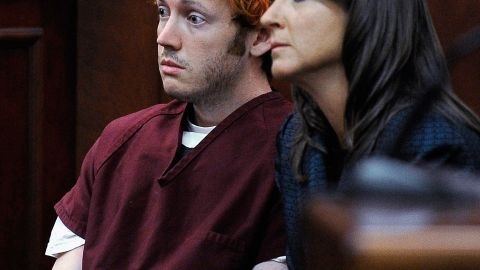 """CENTENNIAL, CO - JULY 23:  James Holmes (L) makes his first court appearance at the Arapahoe County Courthouse with his public defender Tamara Brady on July 23, 2012 in Centennial, Colorado. According to police, Holmes killed 12 people and injured 58 others during a shooting rampage at an opening night screening of """"The Dark Knight Rises"""" July 20, in Aurora, Colorado.  (Photo by RJ Sangosti-Pool/Getty Images)"""