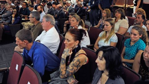 Victims and their relatives and journalists watch the proceedings in 2012.
