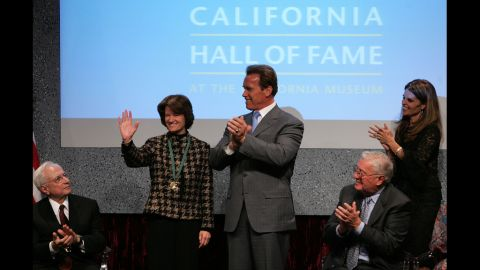 California Gov. Arnold Schwarzenegger applauds Ride after inducting her into the California Hall of Fame in December 2006.
