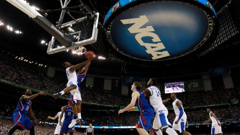 """Kentucky celebrates the 2012 national championship in April. Sixty years earlier, the NCAA opened an investigation into the University of Kentucky Wildcats basketball program, following a national championship season in which three players had been arrested in a point-shaving scandal. The subsequent probe revealed that 10 players had received impermissible financial aid. The NCAA banned the school's entire athletic program from playing for a year -- in effect, marking the advent of the so-called """"death penalty,"""" even though the penalty wasn't given the nickname until the 1980s."""