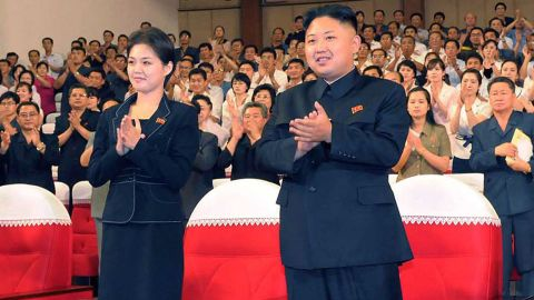 FILES) This file picture taken on July 6, 2012 by North Korean official Korean Central News Agency and released on July 9 shows North Korean leader Kim Jong Un (C), accompanied by a young woman (L), enjoying a demonstration performance given by the newly organized Moranbong band in Pyongyang. North Korean state television on July 25, 2012 confirmed that leader Kim Jong-Un is married and named his wife as Ri Sol-Ju, South Korea's unification ministry said. South Korea's unification ministry said it appeared that Ri was the woman who has been pictured several times at Kim's side at public events in recent weeks. AFP PHOTO / KCNA via KNS / FILES ---EDITORS NOTE--- RESTRICTED TO EDITORIAL USE - MANDATORY CREDIT 'AFP PHOTO / KCNA VIA KNS' - NO MARKETING NO ADVERTISING CAMPAIGNS - DISTRIBUTED AS A SERVICE TO CLIENTS (Photo credit should read KNS/AFP/GettyImages)