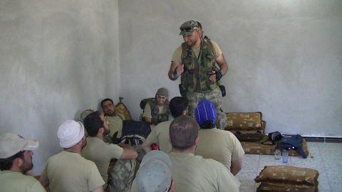 Libyan revolution veteran Al-Mahdi al-Harati (standing) training members of the Liwa al-Umma to fight in Syria.