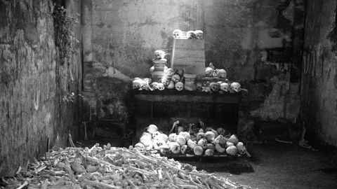 A pile of bones and skulls sits in the Paris Catacombs. Circa 1935