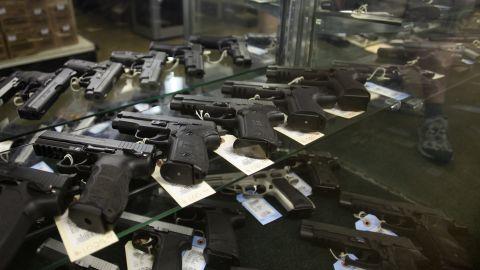 Hand guns are displayed at a firing range July 22, 2012 in Aurora, Colorado.