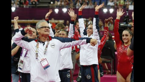 John Geddert celebrates after the US women's team  won gold  at the London Olympic Games on July 31, 2012 at the 2012 London Olympics.