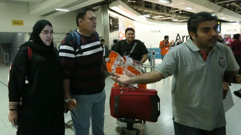 Saudi athlete Wojdan Shaherkani, left, arrives in London with her father for the Olympics on July 25.