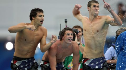 Phelps shouts encouragement to teammates in the 4x200 freestyle in Beijing.