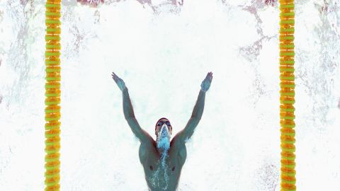 Phelps sets a world record in the 200-meter butterfly in Beijing.