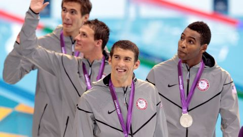 Phelps celebrates with teammates after winning the 4x100 freestyle in London.