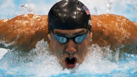 Phelps competes in the men's 200m butterfly final on Day 4 of the London 2012 Olympic Games. Winning a silver medal, his 18th, Phelps matches the record for most decorated Olympian alongside USSR gymnast Larysa Latynina.