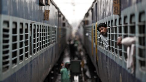 A passenger peers out the window of a train as he waits for electricity to be restored at a railway station in New Delhi on Tuesday. India suffered its second huge power failure in two days on Tuesday, depriving as much as half of the vast and populous country of electricity and disrupting transport networks.