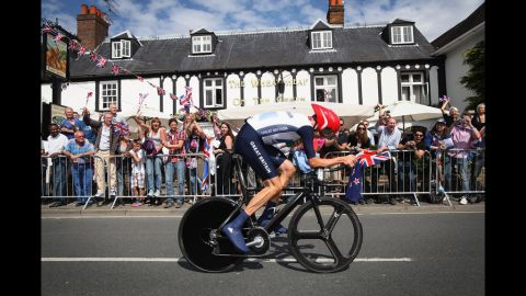 Bradley Wiggins of Great Britain cycles past a pub in Esher during a road cycling event.