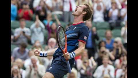 Britain's Andy Murray celebrates after defeating Marcos Baghdatis of Cyprus in their third-round men's singles tennis match.