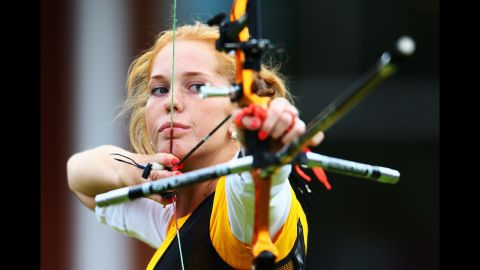 Lidiia Sichenikova of Ukraine competes in the women's individual archery 1/32 eliminations match against Ekaterina Timofeyeva of Belarus.