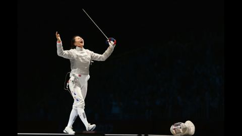 South Korea's Jiyeon Kim celebrates her victory over Sofya Velikaya of Russia in the individual saber finals of women's fencing.