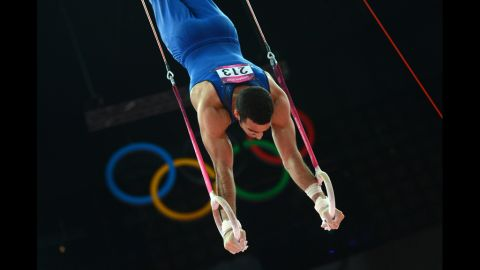 U.S. gymnast Danell Leyva performs on the rings during the nen's individual all-around gymnastics competition.
