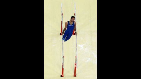 Danell Leyva of the United States competes on the parallel bars in the men's individual all-around gymastics final.