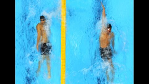 American swimmers Michael Phelps, left, and Ryan Lochte compete in the first semifinal heat of the men's 200-meter individual medley.