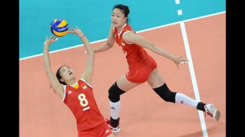 China's Wei Quiyue, left, makes a set shot during a Pool B women's volleyball preliminary match against the United States.